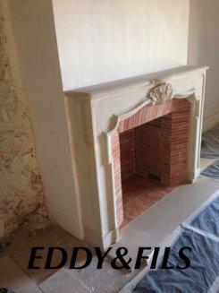 fourniture et installation d'une cheminée en pierre ancienne foyer ouvert briquettes ancienne